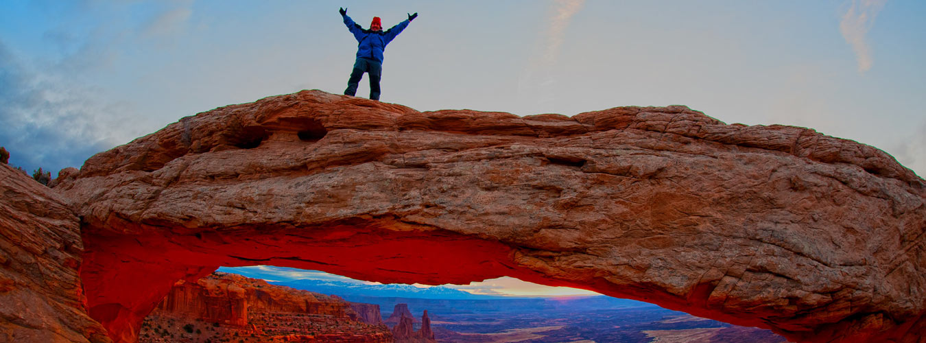 Steve Bein standing on top of Mesa Arch in Canyonlands, Utah.